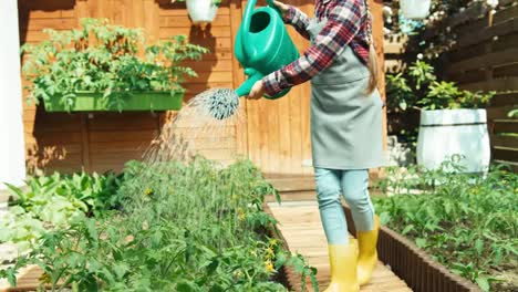 Young-Farmer-Watering-Plants-In-The-Kitchen-Garden