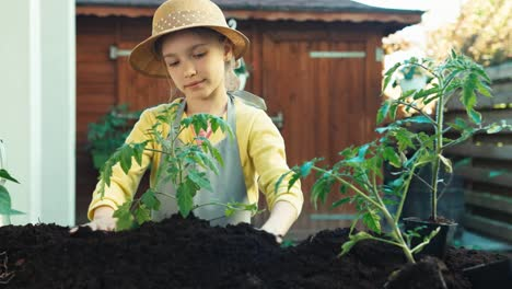 Young-Farmer-With-Seedling-In-The-Kitchen-Garden
