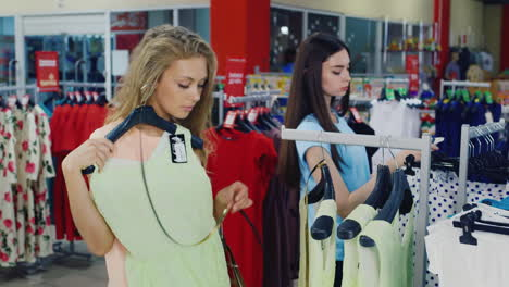 Girls-Choosing-Clothes-In-a-Store