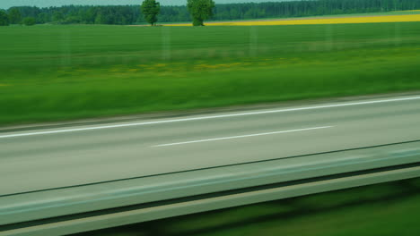 Wide-Highway-And-Green-Fields