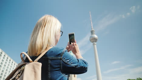 Woman-Takes-Photos-Of-Berlin-TV-Tower