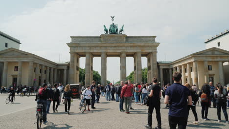 Tourists-by-Brandenburg-Gate-In-Berlin