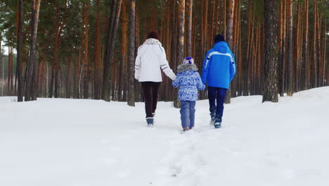 Mother-Walks-With-Her-Two-Children-In-Snow-01