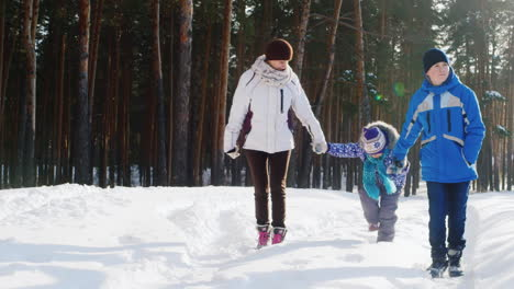 Mother-Walks-With-Her-Two-Children-In-Snow-04