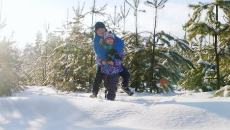 Brother-Plays-With-His-Younger-Sister-In-Snow