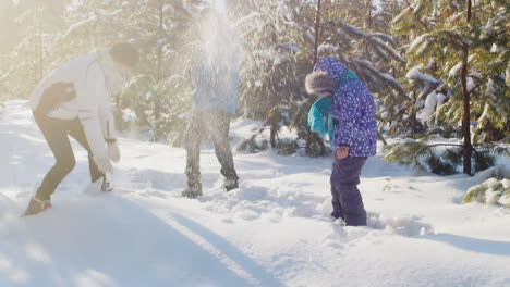 Mother-And-Children-Playing-Around-In-The-Snow
