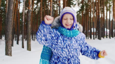 Excited-Young-Girl-In-A-Snowy-Forest-Scene