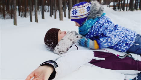 Mother-And-Daughter-Playing-Around-In-The-Snow-01