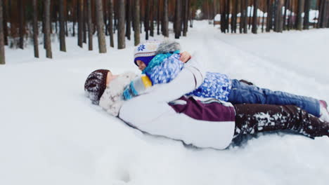 Mother-And-Daughter-Playing-Around-In-The-Snow-02