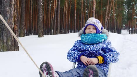 Little-Girl-Being-Pulled-On-Sled-In-The-Snow-01