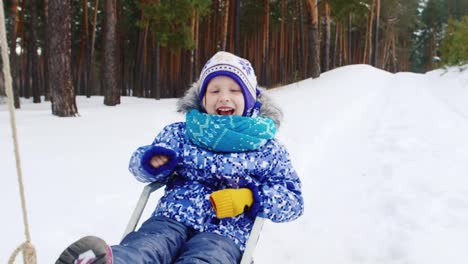 Little-Girl-Being-Pulled-On-Sled-In-The-Snow-02