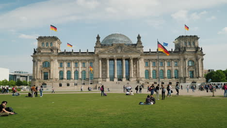Tourists-Rest-Near-The-Bundestag-In-Berlin