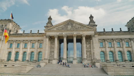 A-Group-Of-Tourists-Enter-The-Bundestag-Building-In-Berlin