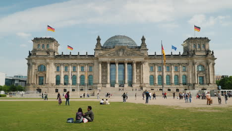 Tourists-And-Locals-Resting-On-The-Lawn-Near-The-Bundestag-Building