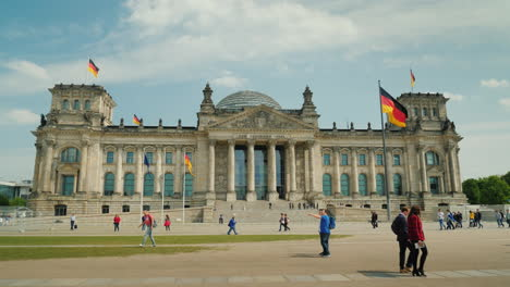 A-Group-Of-Tourists-Enters-The-Bundestag-Building-In-Berlin