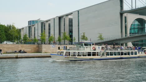 A-Pleasure-Boat-With-Tourists-Against-The-Architecture-Of-Berlin-01