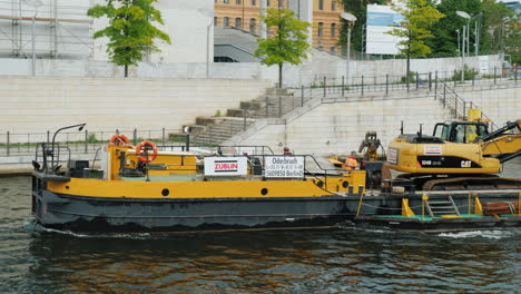 Barge-Carrying-An-Excavator-Along-River
