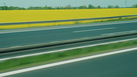 Motorway-In-Germany-With-Fields-Of-Yellow-Rapeseed
