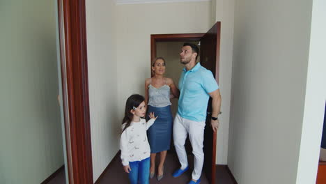 Family-With-Child-Entering-Hotel-Room