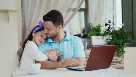 Daughter-Approaches-Father-Using-Laptop
