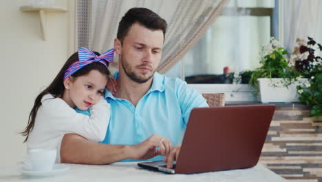 Daughter-Watches-Father-Use-Laptop