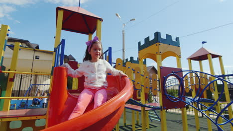 Girl-on-Slide-in-a-Playground