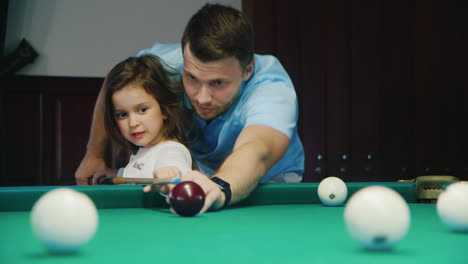 Man-and-Daughter-Play-Billiards