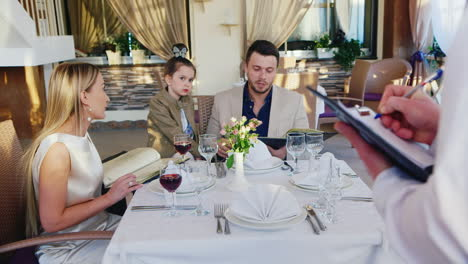 Family-Order-Food-in-Restaurant