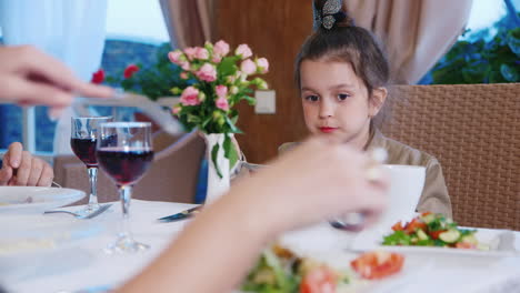 Young-Girl-Eating-in-Restaurant