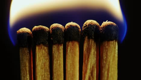 Macro-Shot-Of-Matches-Being-Set-Alight-