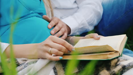 Future-Parents-Read-Book-in-a-Meadow