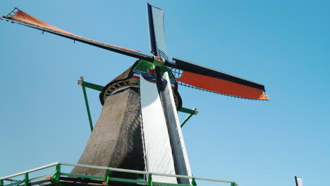 An-Old-Dutch-Windmill-Against-The-Background-Of-The-Blue-Sky-4k-Video