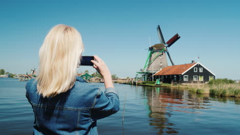 Woman-Photographs-Dutch-Windmills