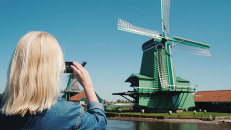Woman-Takes-Pictures-Of-Windmills