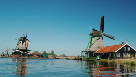 Windmills-On-Dutch-River-Bank