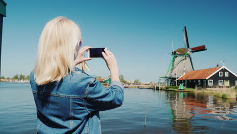 Woman-Takes-Pictures-Of-Dutch-Windmills