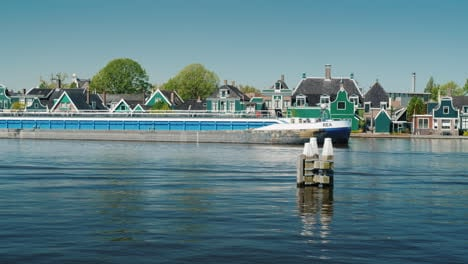 Barge-Sails-Past-Traditional-Dutch-Houses