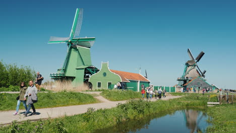 Tourists-Among-Old-Mills-The-Netherlands