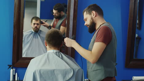 Man-Getting-A-Haircut-In-Barbers-Wide-Shot