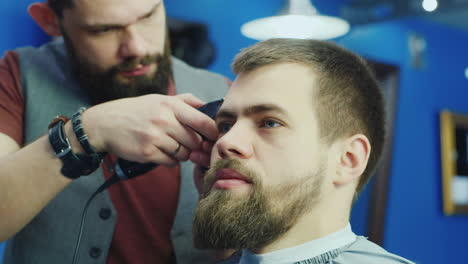 Bearded-Man-Getting-Haircut-In-A-Stylish-Salon