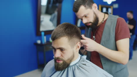 Friendly-Barber-Dries-Hair-Of-His-Client-In-Barbershop-01