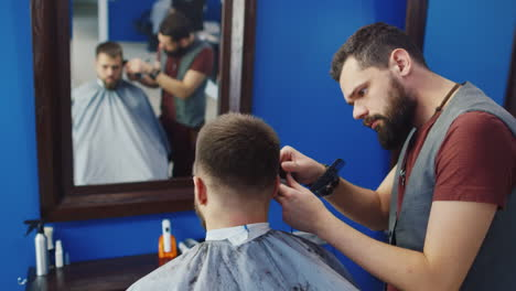 Friendly-Barber-Dries-Hair-Of-His-Client-In-Barbershop-02