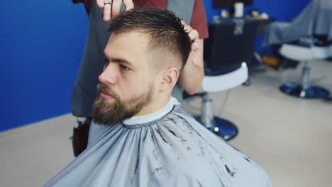 Profile-Of-A-Man-Having-His-Hair-Cut-In-Salon