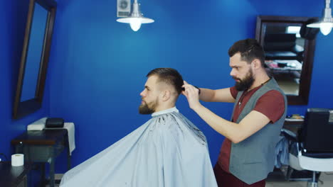 Barber-Cutting-Hair-For-Client-In-A-Barbershop-01
