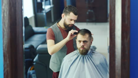 Barber-Cutting-Hair-For-Client-In-A-Barbershop-02
