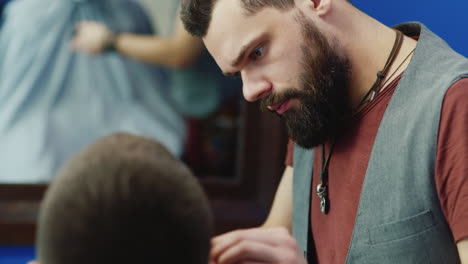 Close-Up-Of-Barber-Working-On-Client-s-Hair-And-Beard-05
