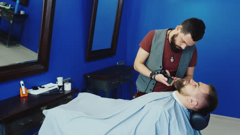 Barber-Grooming-And-Shaping-Beard-In-Hair-Salon