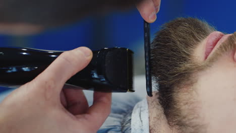Close-Up-Detail-Of-Barber-Shaping-A-Beard-For-A-Client