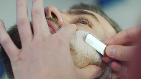 Barber-Using-Razor-Blade-To-Cut-Beard-01