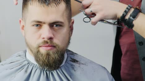 Man-Getting-Hair-Cut-In-A-Barbershop-